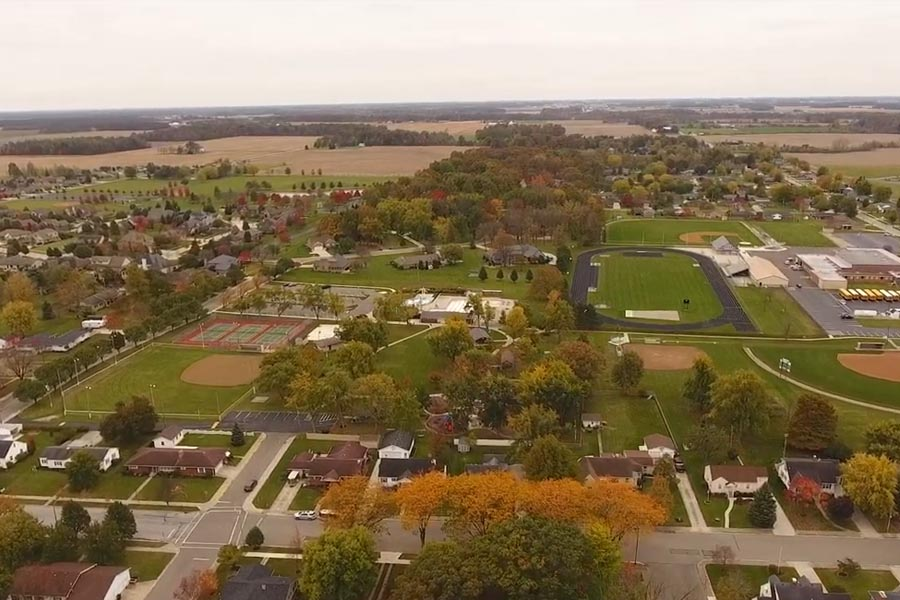 Versailles, OH Insurance - Ohio Small Town Overlooking a High School During the Fall